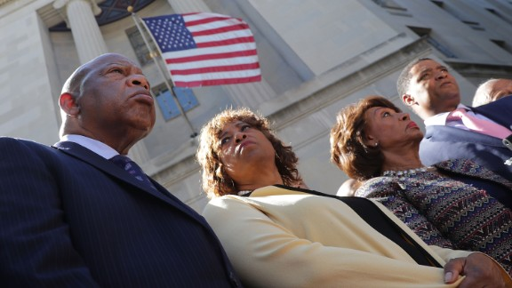 Civil rights pioneer Rep. John Lewis (D-GA), Rep. Brenda Lawrence (D-MI), Rep. Maxine Waters (D-CA), Rep. Cedric Richmond (D-LA) and other members of the Congressional Black Caucus hold a news conference after marching to the Department of Justice from the U.S. Capitol September 22, 2016 in Washington, DC.