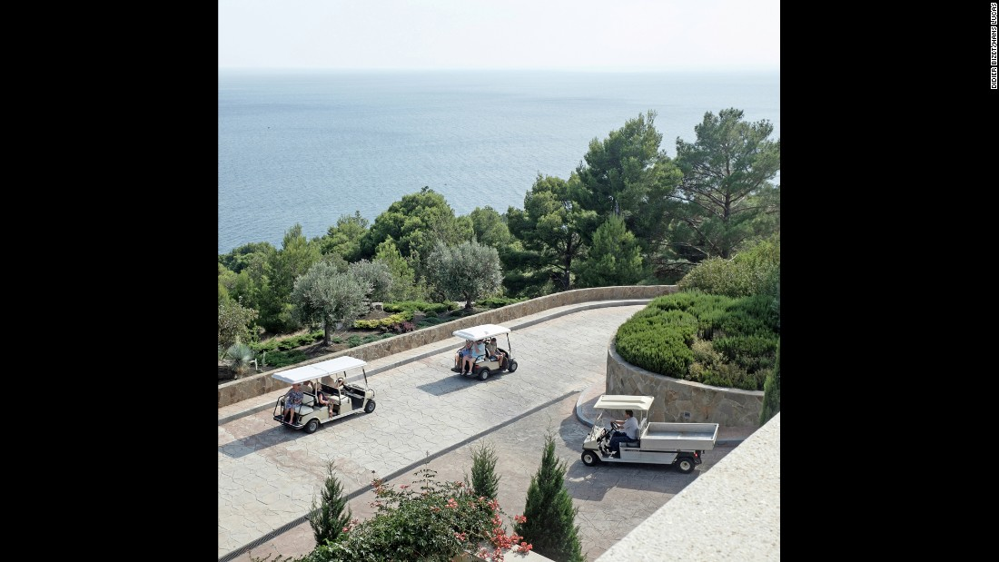 People ride golf carts at a Crimean resort.