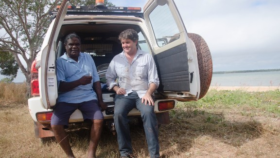 Researcher Michael Westaway taking saliva samples with Elder Thomas Wales.