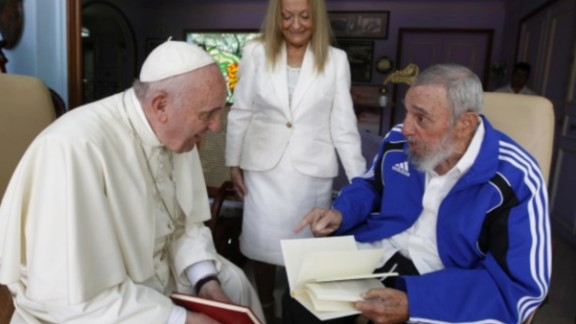 Alex Castro captures his father and mother, Dalia Soto del Valle, meeting with Pope Francis at their home in Havana in 2015. The younger Castro says he focuses on the images and doesn't listen to his father's conversations.