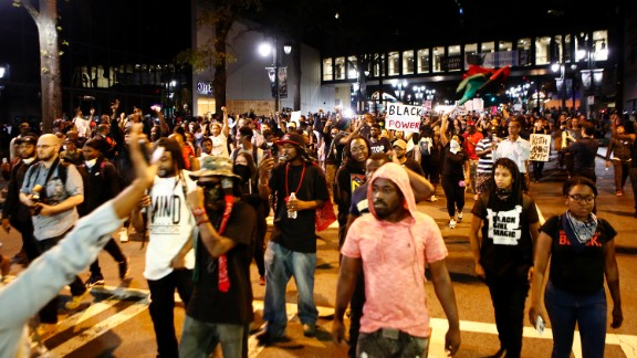 Residents and activists march in the streets of Charlotte on September 22. There was a heavy police presence, and the National Guard was also on hand.