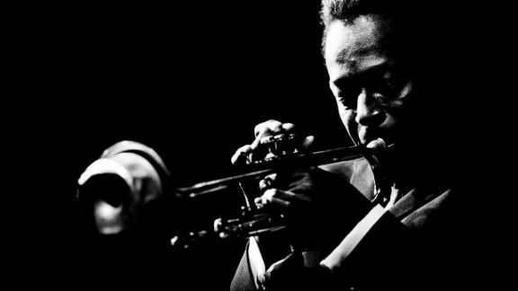 Miles Davis plays the trumpet at the Monterey Jazz Festival in Monterey, California, in 1964. It