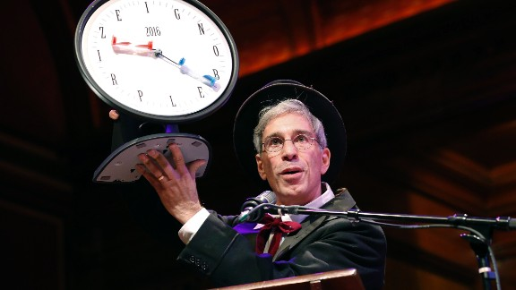 Master of Ceremonies Marc Abrahams holds up the 2016 Ig Nobel award during ceremonies at Harvard University in Cambridge, Mass., Thursday, Sept. 22, 2016.