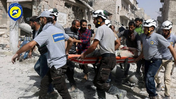 Rescue workers work the site of airstrikes in  the al-Sakhour neighborhood.