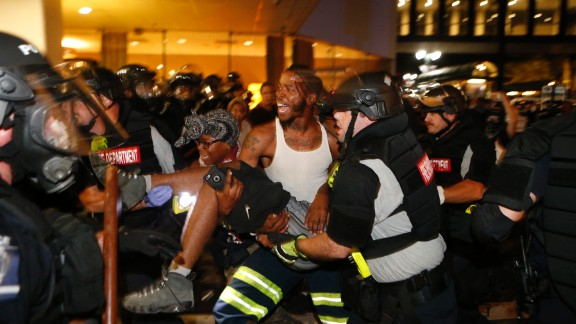 Protesters and police carried Justin Carr after he was shot.