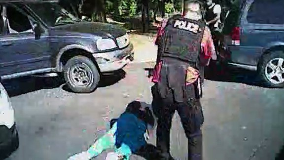An image taken from a police body camera video released by the Charlotte-Mecklenburg Police Department showing moments after  officers shot and killed Keith Scott.