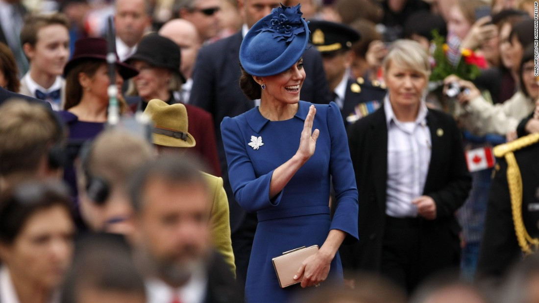 The duchess waves to fans at the Legislative Assembly.