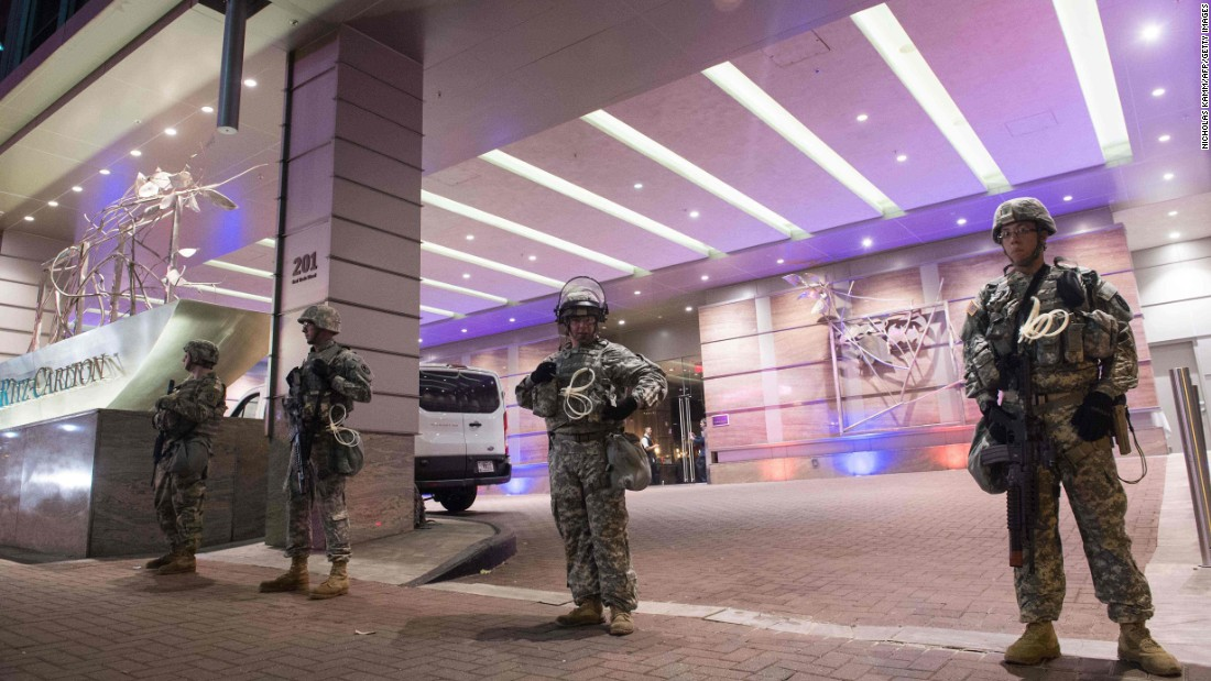 Members of the National Guard stand watch in front of a Charlotte hotel on Friday, September 23.