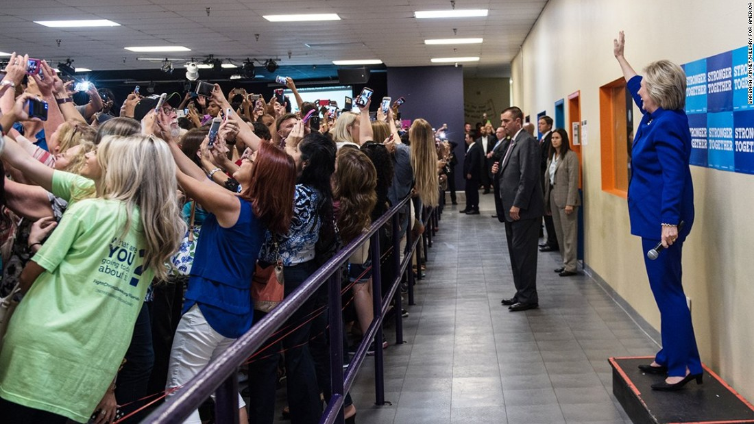 "People <a href=""http://www.cnn.com/2016/09/26/politics/hillary-clinton-crowd-selfie-goes-viral/"" target=""_blank"">take selfies</a> in front of Democratic presidential nominee Hillary Clinton at a campaign rally in Orlando on Sunday, September 25."