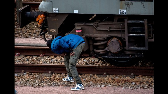 A migrant hides on the train tracks in the direction of the Eurotunnel terminal in August 2015.