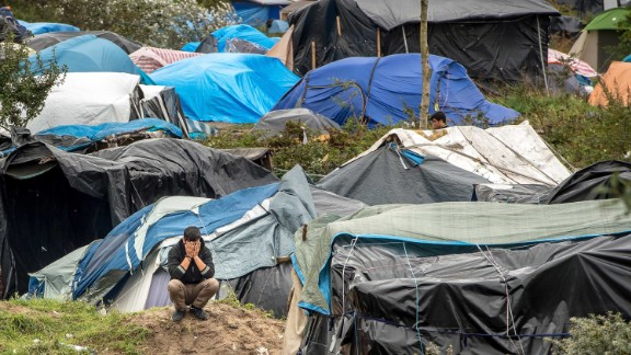 """A man is seen among tents in """"The Jungle"""" in October 2015."""