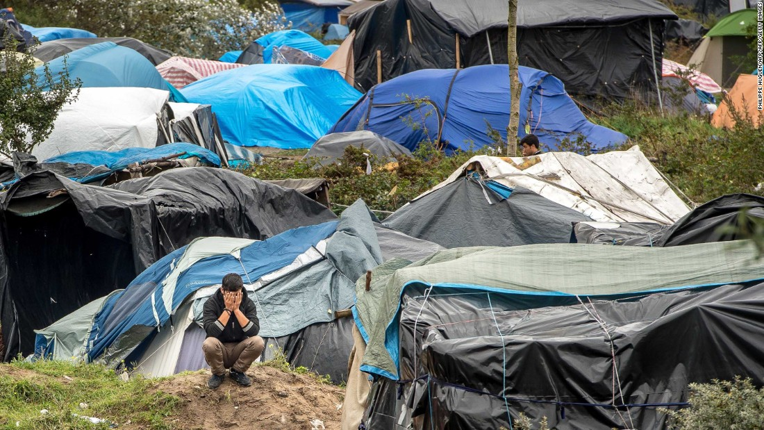 "A man is seen among tents in ""The Jungle"" in October 2015."