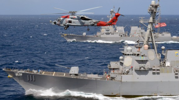 """An MH-60R Seahawk attached to the """"Warbirds"""" of Helicopter Maritime Strike Squadron (HSM) 49, flies over the guided-missile destroyers USS Spruance (DDG 111) and USS Momsen (DDG 92) in July 2016. (U.S. Navy photo by Naval Aircrewman 2nd Class Alex Hewette/Released)"""