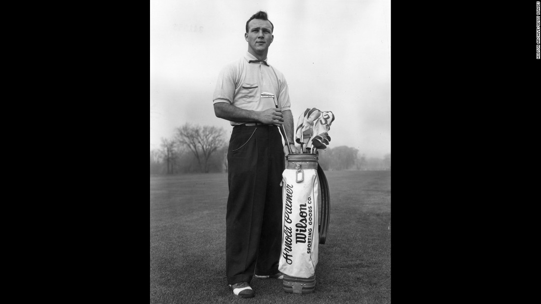 Pictured here circa 1953, a young Arnold Palmer pulls a driving iron from a golf bag. Palmer died Sunday evening, Septmeber 26, while awaiting cardiac surgery at a Pittsburgh hospital, according to a statement from his company.