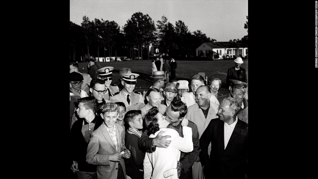 Palmer kisses his wife Winifred Walzer at the end of the tournament 56 years ago.