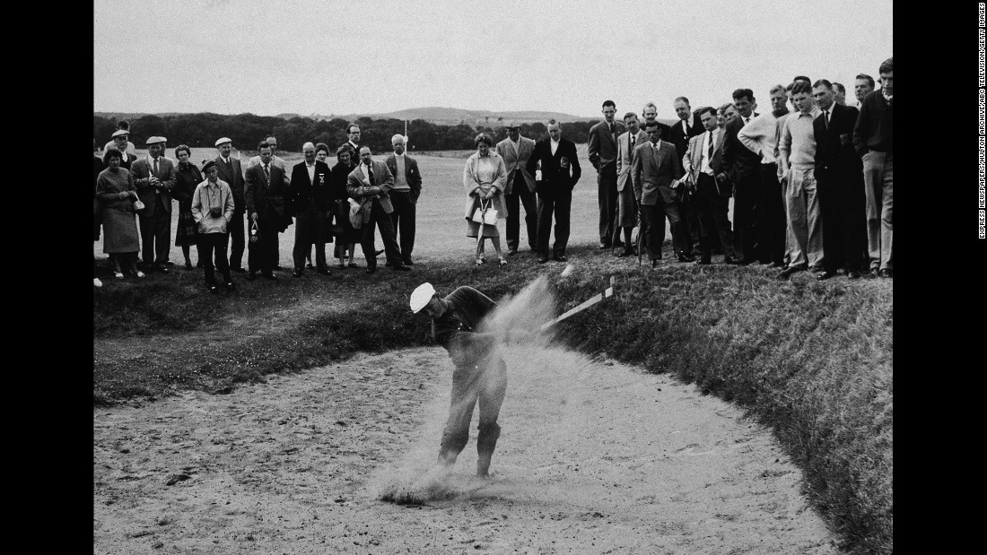A drive out of a sand trap during the British Open Championship at St. Andrews, Scotland, on July 7, 1960.