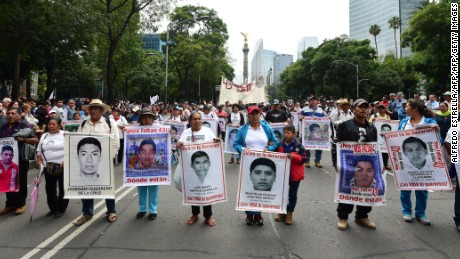 Parents, other relatives and people in general take part in a protest in Mexico City, on September 26, 2016, to commemorate the second anniversary of the Ayotzinapa teachers school's students disappearance.  The students, from a rural teachers college in the southern state of Guerrero, disappeared after they were attacked by local police in the city of Iguala on September 26, 2014. / AFP / ALFREDO ESTRELLA        (Photo credit should read ALFREDO ESTRELLA/AFP/Getty Images)