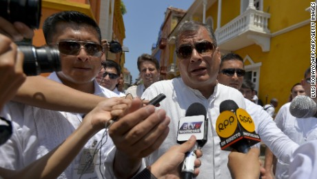 "Ecuadorean President Rafael Correa (R) speaks with journalists upon arriving at the San Pedro Claver church in Cartagena, Colombia, on September 26, 2016. Colombia will turn the page on a half-century conflict that has stained its modern history with blood when the FARC rebels and the government sign a peace deal on Monday. President Juan Manuel Santos and the leader of the FARC, Rodrigo Londono -- better known by his nom de guerre, Timoleon ""Timochenko"" Jimenez -- are set to sign the accord at 2200 GMT in a ceremony in the colorful colonial city of Cartagena on the Caribbean coast. / AFP / LUIS ROBAYO        (Photo credit should read LUIS ROBAYO/AFP/Getty Images)"