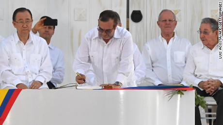 The head of the FARC guerrillas Timoleon Jimenez signs the historic peace agreement between the Colombian government and the Revolutionary Armed Forces of Colombia (FARC), in Cartagena, Colombia, on Monday, September 26.