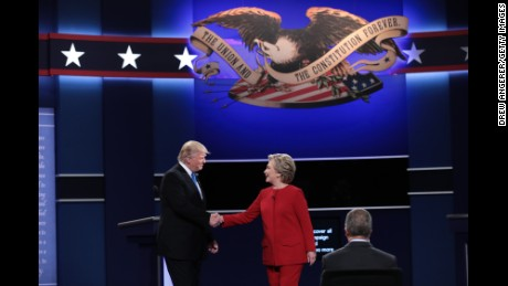(L-R) Republican presidential nominee Donald Trump and Democratic presidential nominee Hillary Clinton shake hands prior to the start of the Presidential Debate at Hofstra University on September 26, 2016 in Hempstead, New York.  The first of four debates for the 2016 Election, three Presidential and one Vice Presidential, is moderated by NBC's Lester Holt.
