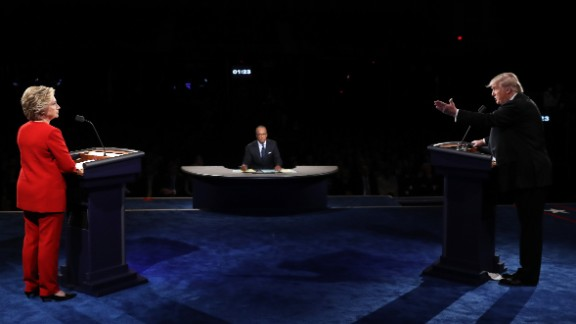 Donald Trump (R) speaks as Hillary Clinton and Moderator Lester Holt listen during the Presidential Debate at Hofstra University on September 26, 2016 in Hempstead, New York.