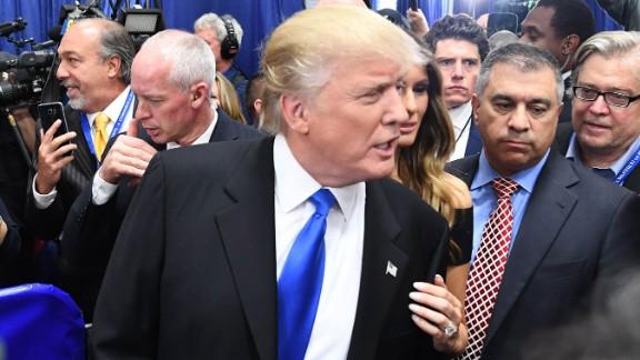 Donald Trump (C) speaks