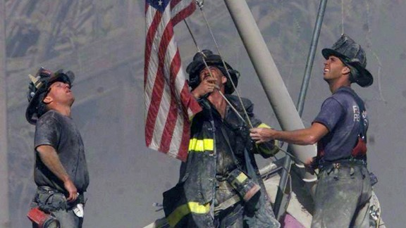 Firefighters George Johnson, Dan McWilliams and Billy Eisengrein raise a flag at ground zero in New York after the terror attacks on September 11, 2001. The scene was immortalized by photographer Thomas E. Franklin. The image has been widely reproduced in the decade since it was first published. View 25 of history