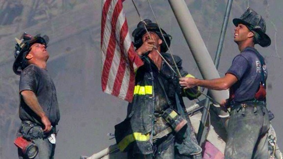 """Firefighters George Johnson, Dan McWilliams and Billy Eisengrein raise a flag at the site of the World Trade Center in New York after the terror attacks on September 11, 2001. The scene was immortalized by photographer Thomas E. Franklin and has been compared to the iconic image of the flag-raising at Iwo Jima. CNN Films' """"The Flag"""" examines what happened to the flag at ground zero and explores its impact in the aftermath of the tragedy."""