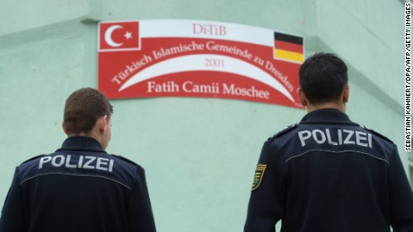 Police stand guard Tuesday at the Fatih Camii mosque in Dresden after a bomb attack.
