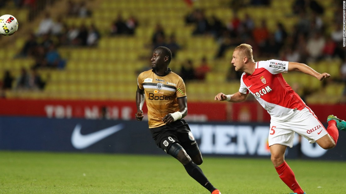 Glik (right) heads the ball against French Ligue 1 side Angers. The match saw an attendance of just 6,075 people.