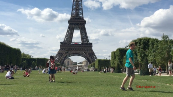 Travis showing off  his skills outside the Eiffel Tower in Paris