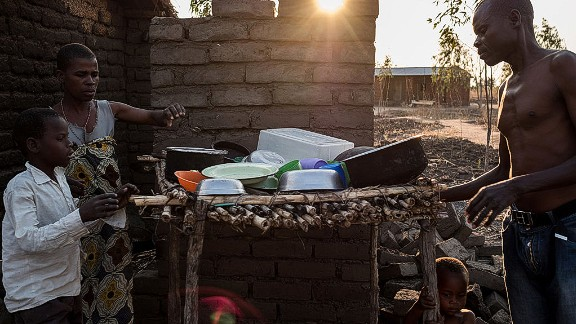 An estimated 6.5 million Malawians -- 39% of the population -- face food shortages and nutrition risks due to the ongoing drought.  Pictured here, a family in one of the affected areas prepare their dinner.