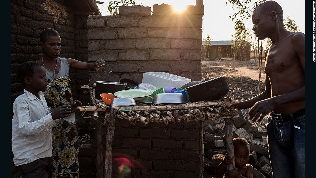 An estimated 6.5 million Malawians -- 39% of the population -- face food shortages and nutrition risks due to the ongoing drought.<br /><br />Pictured here, a family in one of the affected areas prepare their dinner.