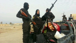 Iraqi housewife and ISIS fighter - CNN