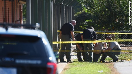 Members of law enforcement investigate an area at Townville Elementary School on Wednesday, September 28 in Townville, South Carolina.  A teenager opened fire at the South Carolina elementary school Wednesday, wounding two students and a teacher before the suspect was taken into custody, authorities said.
