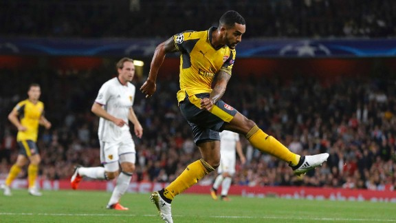 Theo Walcott scored twice as Arsenal eased past FC Basel 2-0 in London.