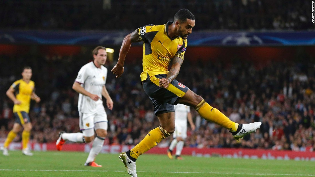 Theo Walcott scored twice as Arsenal eased past FC Basel 2-0 in London.