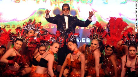 Amitabh Bachchan poses with dancers during the announcement of the forthcoming Hindi film, 'Aankhen 2', directed by Anees Bazmee in Mumbai late August 17, 2016.
