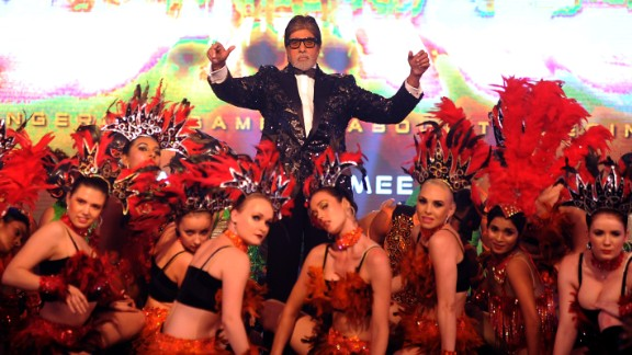 Amitabh Bachchan poses with dancers during the announcement of the forthcoming Hindi film,