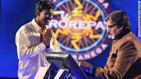 "Sushil Kumar, 27, (L) gestures as he receives his one million USD prize from Bachchan during the fifth season of the Indian version of ""Who Wants to be a Millionaire?"""