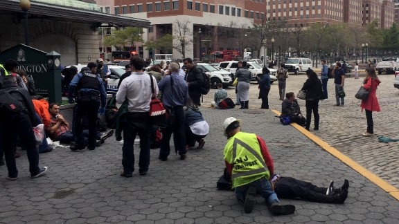People are treated for their injuries outside after a NJ Transit train crashed in to the platform at Hoboken Terminal September 29, 2016 in Hoboken, New Jersey.New Jersey emergency's management system is reporting more than 100 people were injured in the crash.