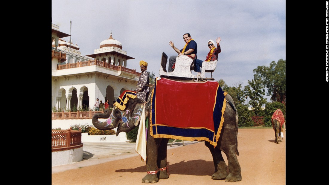 Justice Antonin Scalia and Ruth Bader Ginsburg pose on an elephant in Rajistan during their tour of India in 1994.