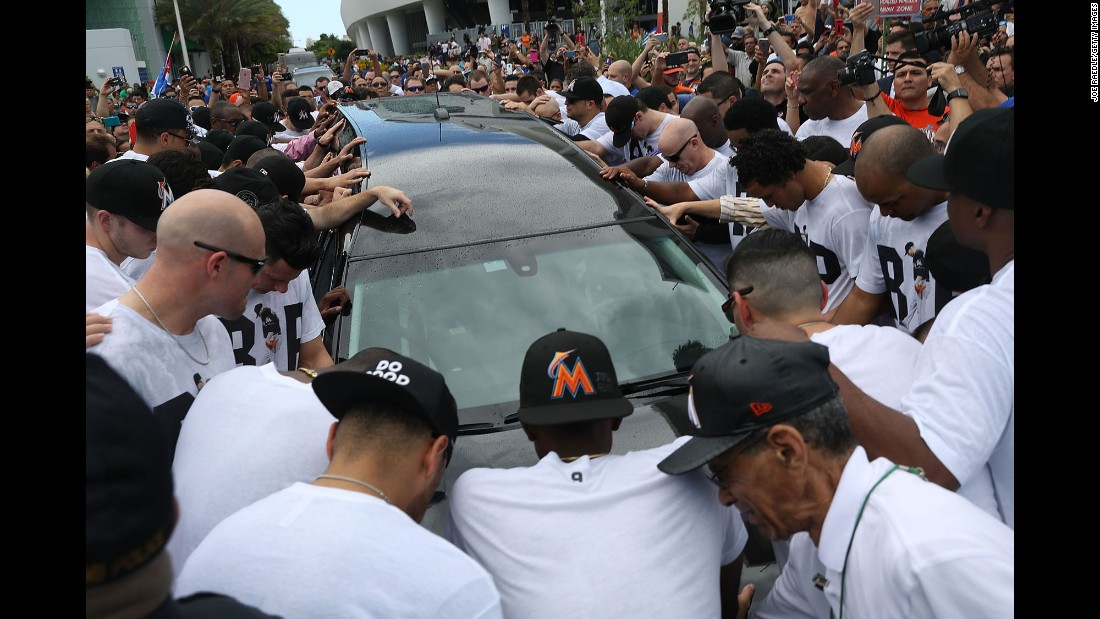 "<strong>September 28:</strong> Baseball fans and members of the Miami Marlins organization surround the hearse carrying Marlins pitcher Jose Fernandez, <a href=""http://www.cnn.com/2016/09/28/us/miami-jose-fernandez-procession/"" target=""_blank"">who died in a boating accident.</a> Fernandez, a 24-year-old native of Santa Clara, Cuba, was a beloved figure in Miami, where so many of his countrymen have settled and prospered. He was a two-time All-Star and the National League's Rookie of the Year in 2013."
