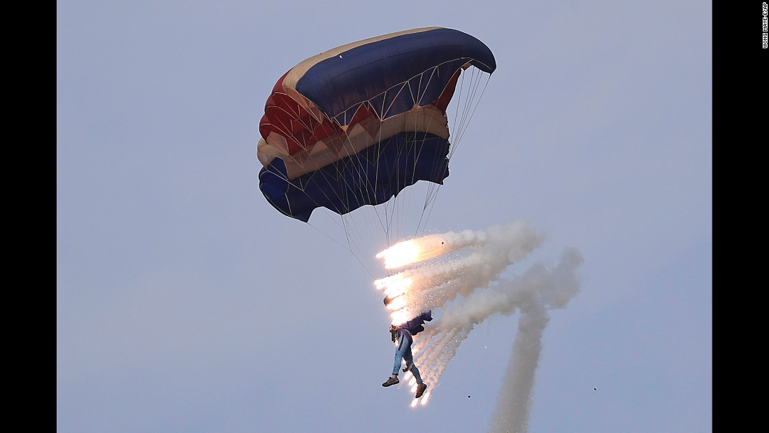 "Pyrotechnics are seen Sunday, September 25, as a military parachutist descends on Kalma Airport in Wonsan, North Korea. Thousands of Koreans and hundreds of foreign tourists and journalists were invited to the port city for the Wonsan International Friendship Air Festival. <a href=""http://www.cnn.com/videos/world/2016/09/26/north-korea-air-show-sfc-orig.cnn"" target=""_blank"">Video: North Korea shows off its air force</a>"