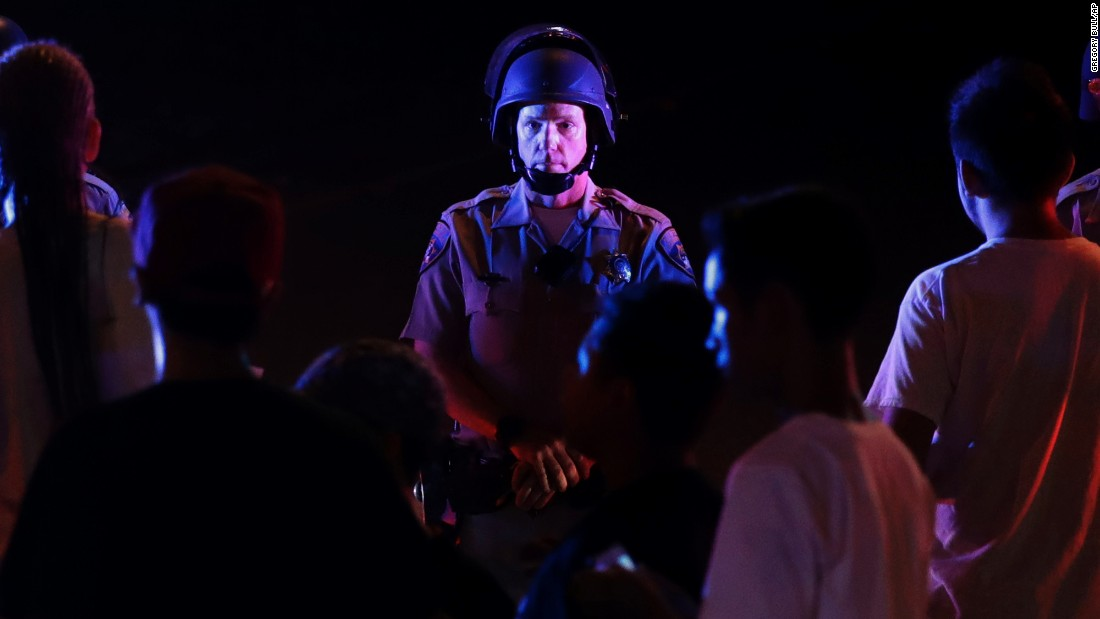 "A police officer blocks a freeway ramp during a protest in El Cajon, California, on Wednesday, September 28. Dozens of demonstrators were protesting<a href=""http://www.cnn.com/2016/09/28/us/california-police-shooting/index.html"" target=""_blank""> the killing of Alfred Olango,</a> a Ugandan refugee shot by a police officer after he pulled an object from a pocket, pointed it and assumed a ""shooting stance,"" authorities said."