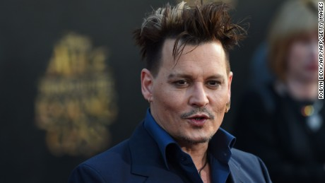 "Actor Johnny Depp attends the premiere of Disney's ""Alice Through The Looking Glass,"" May 23, 2106 at the El Capitan Theatre in Hollywood, California. / AFP / Robyn BECK        (Photo credit should read ROBYN BECK/AFP/Getty Images)"