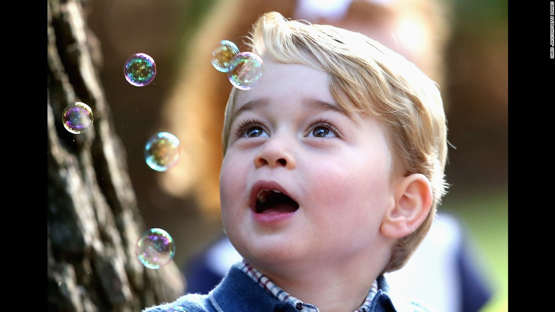 Britain's Prince George plays with bubbles at a children's party in Victoria, British Columbia, on Thursday, September 29.