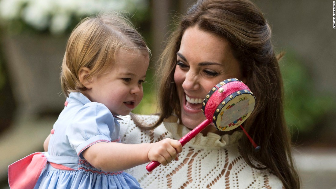 The duchess and Princess Charlotte enjoy the fun during the party on September 29.