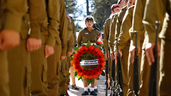 Israeli soldiers hold wreaths before making their way to the graveside.