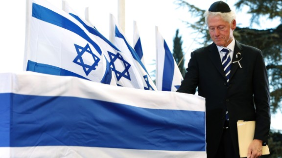 Clinton touches Peres
